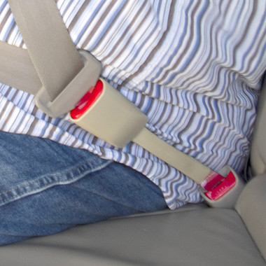 "Rigid 11"" Beige Seat Belt Extender in use by a passenger."