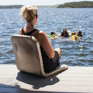 Folding Poolside Chair provides back support and protection for your legs from the side of concrete pools, wooden docks or rocky shorelines.