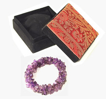 Includes deluxe silk embroidered gift box