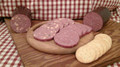 This is some tasty summer sausage and it's always a big seller.  Southwest flavors of jalapenos and chiles in a lean summer sausage with chunks of cheddar cheese. Smoked with hickory wood. Gluten free. No MSG.