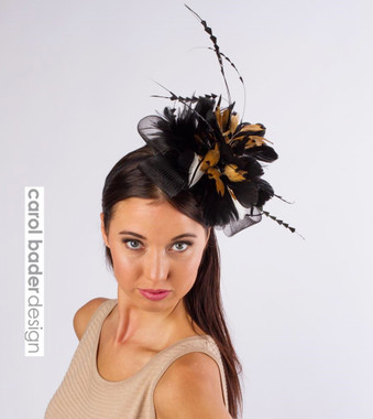 Black,camel, white mix. Mounted on headband.