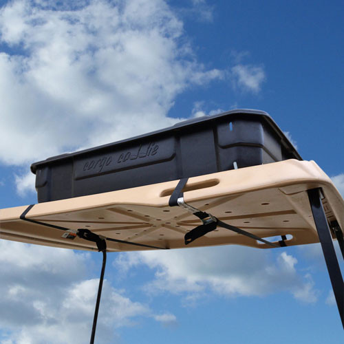 Lightweight hard plastic cargo box fits on top of flip seat cargo bed.