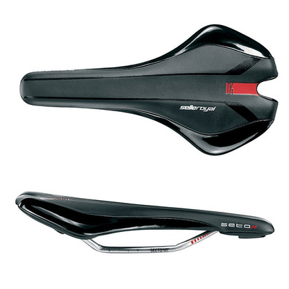 Seta S1 is the top saddle in our FLAT range: a lightweight, handmade, high performance saddle conceived and developed by designer Yoshio Motoki to have a flat-topped surface to improve flexibility, regardless of a rider's seated position.  Flat Unisex Width: 144mm Length: 280mm Weight: 230g