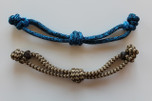 1/4 Inch Chin Strap Colors Shown From Top to Bottom: Navy/Pacific Blue Blend and Brown/Tan Zig Zag Pattern.