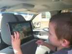 Tablet headrest mount with Kid in Car Seat