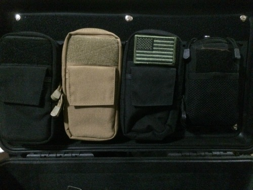pelican-molle-lid-organizer-black-with-cases-snapped-in.jpg