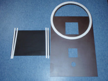 Here is a top plate painted bark brown metallic and a divider plate painted black. The round white gasket fits underneath a 55 gallon steel drum; it prevents the exhaust gases from escaping into the room. Gaskets on both sides of the divider plate also divide the exhaust gases from the incoming air for combustion around the burn tunnel.