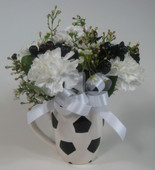 floral arrangement in soccer ball mug