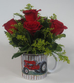 Red roses in tractor mug