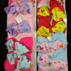 "4 Pack 2.5"" Gaotr Clip Bow w/ Heart Print .50 per set"