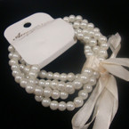 4 Strand Cream Color Glass Pearl Stretch Bracelets .56 per set