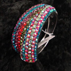 "1.75"" Wide Silver Hinged Bangle Loaded w/ Mixed Color Crystals sold by pc $ 2.50 ea"