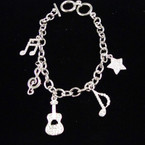 Silver Music Note Charm Bracelets w./ Crystal Stones sold by pc $ 1.50 ea
