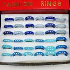 Asst Color Bluetone Glass Rings 36 per bx .25 ea