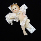 "3"" Poly Resin Angel Magnets on Cross 10 pc per sale @ .50 ea"