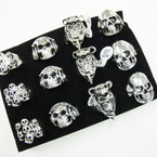 Chunky Cast Silver Skull Rings 4-asst styles  .54 ea