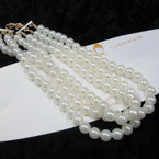 3 Strand Pearl Fashion Fashion Necklace .56 ea