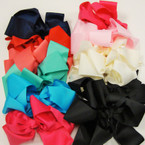 "6-7"""" Asst Color Gator Clip Bows w/ Ribbon Center  .54 each"