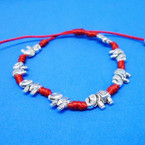 Cast Silver Elephant Bracelet on Handmade Red Cord .52 each
