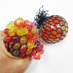"2.5"" Multi Color Mesh Squish Balls 12 per display box .56 each"