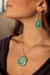 round necklace with oval earrings