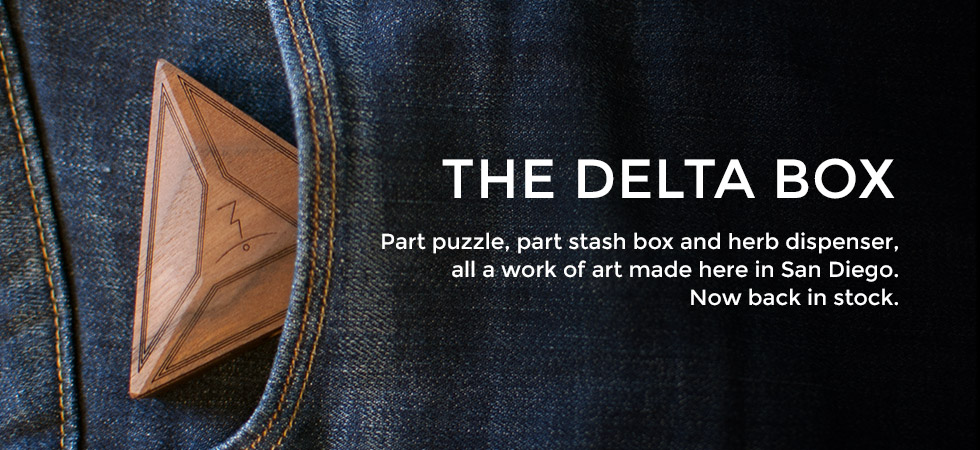 The Delta Box in denim pants pocket - Part puzzle, part stash box and herb dispenser, all a work of art made here in San Diego - Now back in stock - Artisan Collection - Magic-Flight