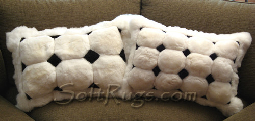 Two White Puffs With Black Diamond Accents Alpaca pillow.