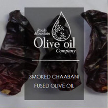 Tunisian Chaabani Peppers are dried in kilns and then smoked using olive wood. Then, the dried peppers are ground with olives to produce this unique and mildly spiced oil. It's bright red-orange color really makes it pop!