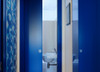 This downstairs toilet door is both colourful and space-saving. The owners of this property have installed an Eclisse pocket door to make the most of a very small area for a downstairs toilet.