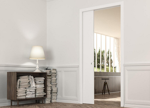 Eclisse single pocket door system with architrave. The Eclisse range of classic pocket door systems are systems that require finishing with architrave and suit both traditional and more contemporary interiors.