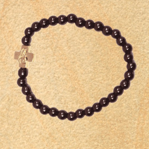Prayer Bracelet with small gold-tone cross and black hematite beads.
