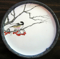Small winter bird decorative plate.