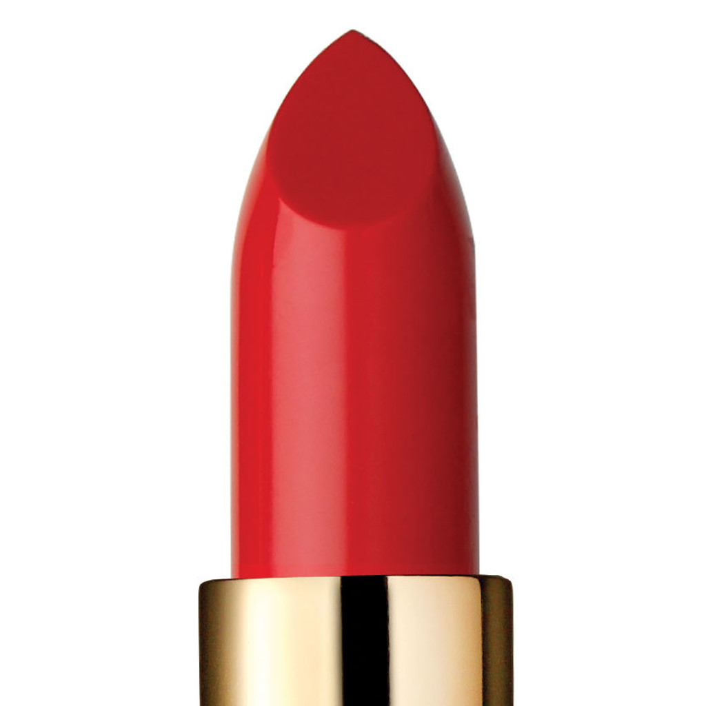 Closeup of vintage red lipstick and top of gold tube