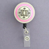 Pink Dog Paw Prints Badge Reel