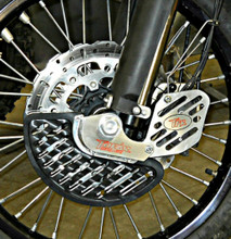 KTM FRONT BRAKE DISC GUARD KIT, FOR LEFT SIDE, FITS 2009-2012 950 and 990 ADVENTURE MODELS  SHOWN here as a COMPLETE KIT INSTALLED ON BIKE WITH UMHW PLASTIC DISC GUARD FIN OPTION and OPTIONAL CALIPER GUARD - CLOSE UP  KFD-100-990-L