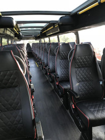 All leather seating on the second floor of the double decker bus.
