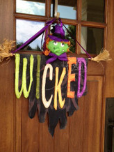 Display on your front door. Dowel and Ribbon Included.