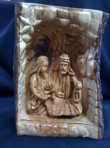 Holy Family in the bark of wood