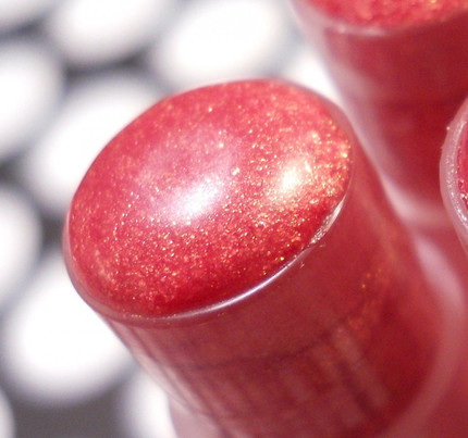 Gilded Ruby Lip Tint Tinted Lip Balm Shimmer Gloss  I found my favorite color! This is the most gorgeous ruby color with lots of gold shimmer it just makes you radiant and beam with happiness.   Looking for an extreme shimmer and shine in one? You've just found it :) This a very beautiful extreme shimmer and shine stix that will enhance any look you're going for by adding a 2nd layer of dimension and in an all natural formula. Wear alone for an extreme shimmer and shine or over your favorite Lip Tint for added dimension, extreme sparkle and shine. Perfect for everyday at work, home or play.  MORE PURE 'GRAPENESS' IN A STICK!   My Shimmer Stix are very moisturizing and made with Avocado and Jojoba oils and they provide tons of shimmer and shine to lips. Perfect to wear alone for a natural shimmer and shine or over Lip Tintx for a big burst of shimmer and shine with color.   How about pairing this up with a Sugary Lip Scrub so that your lips look their very best in your new color?  http://www.etsy.com/shop/forgoodnessgrape?section_id=7104793  Just put one in your purse or in your pocket and you are good to go!   Feels GRAPE on lips and makes lips feel GRAPE!   Follow this link to see more of my Great Lip Tintx and Shimmer Stix in different colors: http://www.etsy.com/shop/forgoodnessgrape?section_id=7066282  Made with natural and paraben free ingredients and all are free from petroleum jelly and or its derivatives. This is a GRAPE combination of nourishing oils blended by hand in small batches for superior freshness and quality control then poured by hand into eco-friendly packaging.  This listing is for 1 Shimmer Stix and contains approximately .07 oz