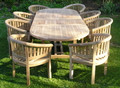 Oval Teak Extending Double Leaf Table Set with Banana Arm Chairs