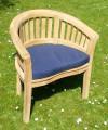 Deluxe Teak Banana Arm Chair teak garden furniture from chairsandtables.co.uk