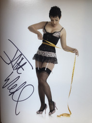 Signed by Jane - in stockings with a measuring tape