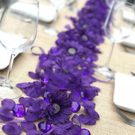 Purple Centerpiece Package - Petals Daisies Jewels Ribbon- Wedding Reception Party Birthday Anniversary Graduation Decor- shown down the center of a banquet table