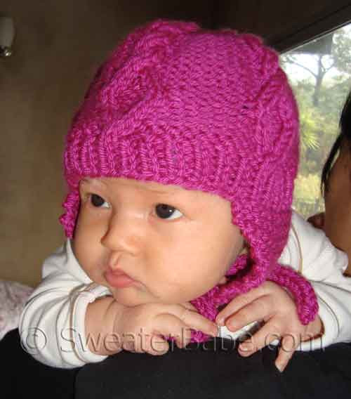 PDF Knitting Pattern for Diamond Cable Baby Hat from SweaterBabe.com.