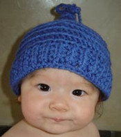 photo of #59 Bobble Tie Crochet Baby Hat