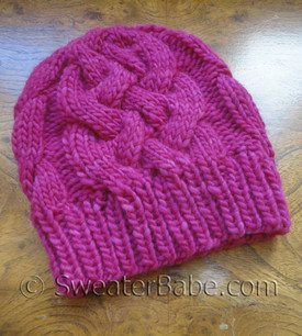 knitting pattern for sublime cabled hat - shown in baby size