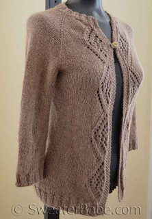 diamonds and lace top-down cardigan knitting pattern. shown in size XS.