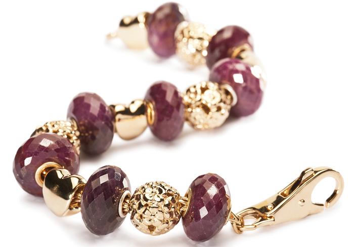 Драгоценные и поделочные камни  Trollbeads-ruby-gold
