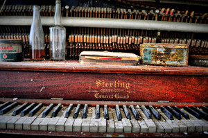 I found this old piano in the abandoned Allegany County Home, Angelica. I loved the color to the piano and the random bottles and cigar case on the top.