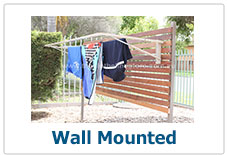A wall mounted folding clothes line